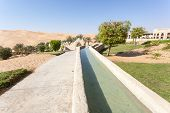 pic of emirates  - Irrigation canal in a desert resort. Emirate of Abu Dhabi United Arab Emirates