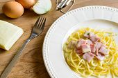 stock photo of carbonara  - spaghetti carbonara on wooden table with ingredient - JPG