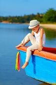 picture of panama hat  - cute kid boy sitting on the bow of a boat - JPG