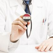 image of iraq  - Doctor holding stethoscope with flag of Iraq - JPG