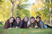 pic of bff  - Group of five male and female teens laying down outdoors - JPG
