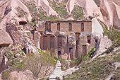 foto of chimney rock  - Home built into the soft rock cliffs of Cappadocia Turkey - JPG