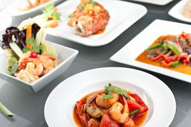 pic of red snapper  - Variety of Thai style whole fish red snapper sweet and sour shrimp gyoza dumplings sesame breads seafood salad and other spicy Thai dishes - JPG