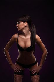 picture of carnal  - lovely young woman in lingerie body posing over dark blue background studio - JPG