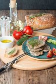 picture of liver  - liver patties with vegetables bread and olive oil on wooden background - JPG