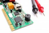 stock photo of  multimeter  - Closeup of cable multimeter and circuit board isolated on white background - JPG