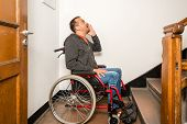 picture of shout  - a disabled man in a wheelchair is facing a barrier of stairs - JPG