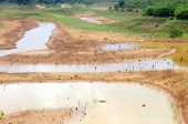 stock photo of drought  - Hot summer water source exhaustion bottom of lake became drought land water security is environment problem of global change climate make disaster - JPG