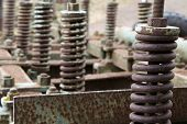 stock photo of machinery  - manual gears of an old agricultural machinery - JPG