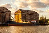 stock photo of loading dock  - Grain Ship being loaded in Port of Gdansk - JPG