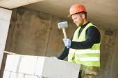 picture of bricklayer  - Bricklaying work - JPG
