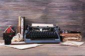 stock photo of typewriter  - Retro typewriter on wooden background - JPG