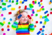 image of preschool  - Preschooler child playing with colorful toy blocks - JPG