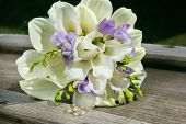 pic of calla  - bridal bouquet with white callas and wedding rings - JPG