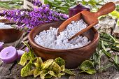 foto of salt-bowl  - salt bath in wooden bowl with flowers and leaves in background - JPG