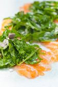 pic of rocket salad  - fresh salmon carpaccio sushi sashimi with arugula rocket salad and caper on top - JPG