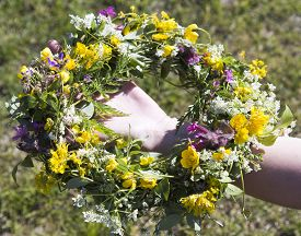 stock photo of headgear  - Swedish Midsummer Headgear Traditional held by a female hand - JPG