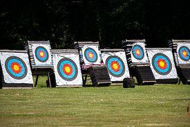 foto of archery  - Archery targets at the range outside in a field - JPG
