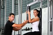picture of personal trainer  - woman in the fitness gim working out with personal trainer coach - JPG