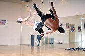 stock photo of break-dance  - young man performing break dance in dance studio - JPG