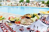 stock photo of buffet catering  - catering buffet food outdoor in luxury restaurant with meat and colorful fruits - JPG