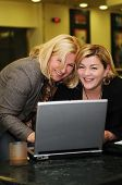 stock photo of people work  - two happy mature senior business  woman work on laptop computer - JPG