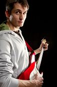 picture of stratocaster  - male with red elegtric guitar playing solo - JPG