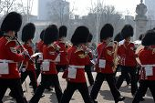 stock photo of beefeater  - Buckingham Palace Army Parade in the Streets of London - JPG