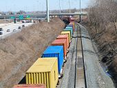 image of boxcar  - Freight cars with trailers on a train passing below - JPG