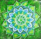 stock photo of chakra  - abstract green painted picture with circle pattern mandala of anahata chakra - JPG
