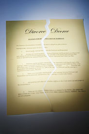 stock photo of divorce-papers  - a divorce decree document ripped in two - JPG