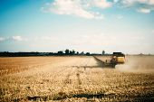 Picture Of Combine Harvester Machine Harvesting Ripe Crops poster