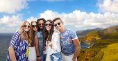 tourism, travel and summer holidays concept - smiling young hippie friends taking picture by selfie  poster