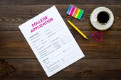 Apply College. Empty College Application Form Near Coffee Cup And Stationery On Dark Wooden Backgrou poster
