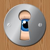 stock photo of peeping tom  - eye looks through keyhole  - JPG