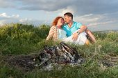 Couple On A Picnic. Picnic For Couple Before Rain. Happy Couple In Love At A Picnic With Bonfire. Yo poster