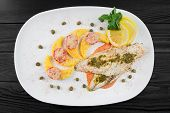 Fillet Of Fish Pangasius With Ananas And Capere poster