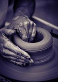 stock photo of pottery  - Hands working on pottery wheel  - JPG