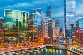 Chicago, Illinois, USA cityscape over the river at twilight. poster