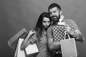 Shopping And Fashion Concept. Bearded Man Holds Shopping Bag And Box. Guy With Beard And Pretty Lady poster