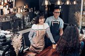 Asia Barista Waiter And Waitress Take Order From Customer In Coffee Shop,two Cafe Owner Writing Drin poster