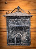 Old Weathered Mailbox Hanging On A Wooden Brown Door poster