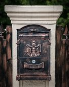 Bronze Mailbox On A White Pillar Made Of Stone, Fence poster