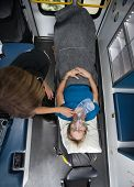 foto of triage  - Above view of senior woman in ambulance with EMT worker - JPG