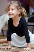stock photo of tooth gap  - Little girl carries out exercise  - JPG