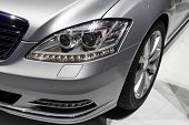 foto of headlight  - Headlight and rim of a silver luxurious car - JPG