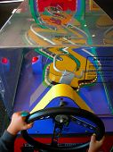Child Playing Arcade Driving Game poster