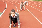 image of track field  - Businesswoman at athletic stadium and race track - JPG