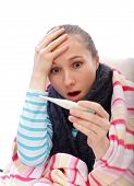 picture of pharyngitis  - Young woman suffering from influenza and scared from the high temperature - JPG