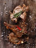 pic of lamb chops  - Delicious lamb chops on wooden table - JPG